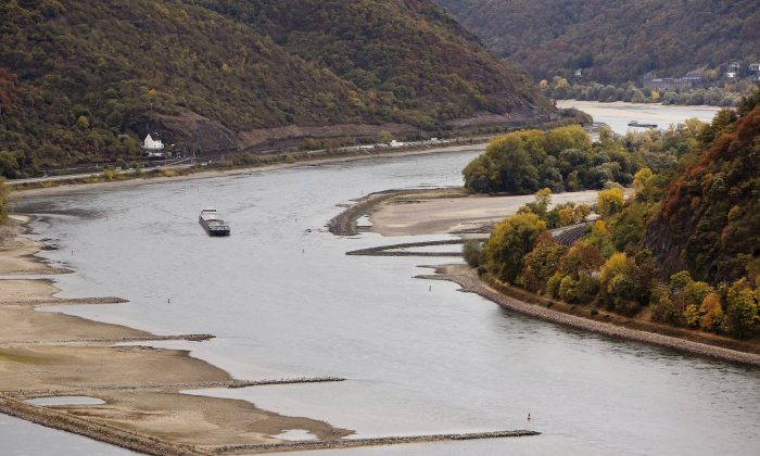 A cargo ship passes sandbanks near Kaub, Germany during historically low water on the river Rhin on Oct. 24, 2018. (AP Photo/Michael Probst)