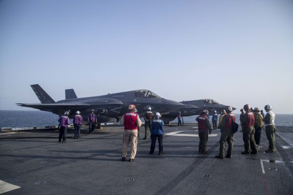 U.S. Marines and Sailors with F-35 on USS Essex