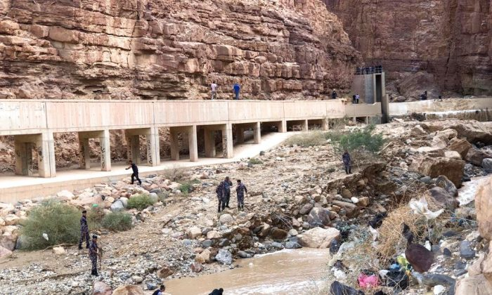 Jordanian rescuers search for survivors of flash floods at the Dead Sea area, Jordan, on Oct. 26, 2018.  (AP Photo/Omar Akour)