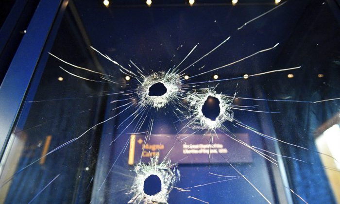 Hammer holes in the glass case that housed the Magna Carta, at Salisbury Cathedral after a 45-year-old man has been arrested on suspicion of its attempted theft, in Salisbury, England, on  Oct. 26, 2018.  (Ben Birchall/PA via AP)