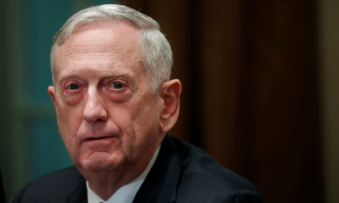 Defense Secretary James Mattis listens as President Donald Trump (not pictured) speaks to the news media while gathering for a briefing from his senior military leaders in the Cabinet Room at the White House in Washington, U.S., Oct. 23, 2018. (Leah Millis/Reuters)