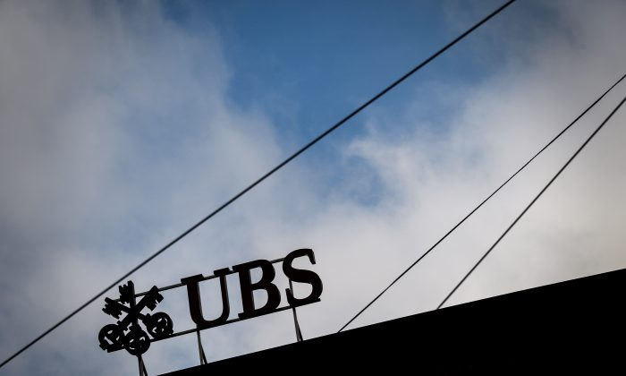 A sign of Swiss banking giant UBS is seen in silhouette in Zurich on Oct. 26. (Fabrice Coffrini /AFP/Getty Images)