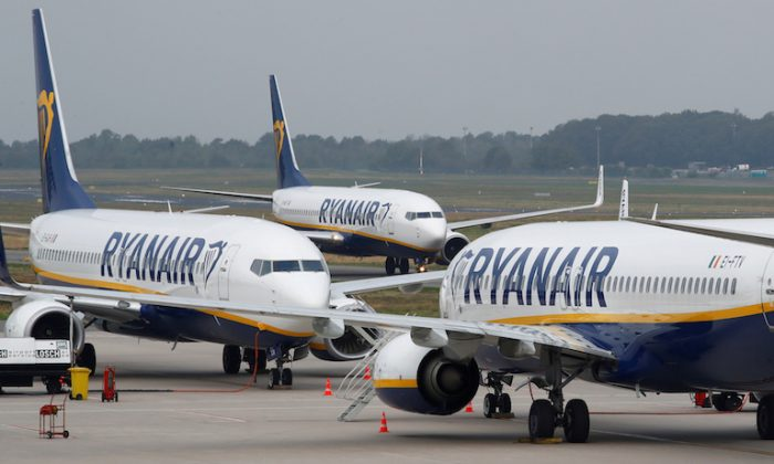 A Ryanair airplane taxis past two parked aircraft at Weeze Airport, near the German-Dutch border, during a strike of Ryanair airline crews in Weeze, Germany, Sept. 12, 2018. (Reuters/Wolfgang Rattay)