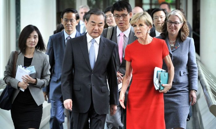 Australia's former Foreign Minister Julie Bishop (front R) walks with her then-Chinese counterpart Wang Yi (front L) at Parliament House in Canberra on Feb. 7, 2017. (Mark Graham/AFP/Getty Images)