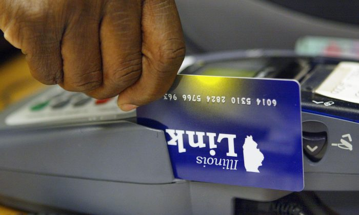 An Illinois Link card, an electronic debit-like card used to draw on food stamp benefits in Skokie, Ill., on June 24, 2004. (Tim Boyle/Getty Images)
