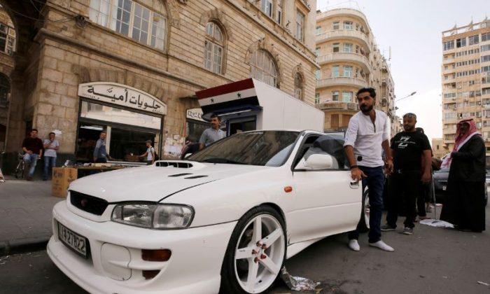 A Jordanian man opens the door of his car in Damascus, Syria Oct. 25, 2018. (Omar Sanadiki/Reuters)