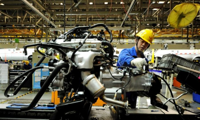 An employee works on an assembly line producing automobiles at a factory in Qingdao, Shandong Province, China on March 1, 2016. (Reuters)