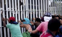 Video: Migrants Breach Border Fence, Throw Rocks, Are Repelled by Border Patrol
