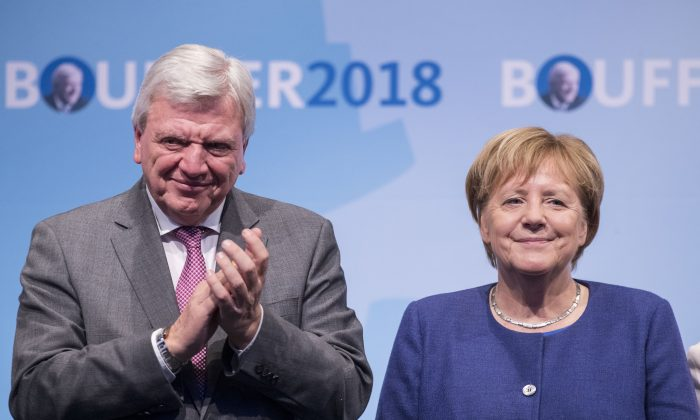German Chancellor and leader of the German Christian Democrats (CDU) Angela Merkel and lead local CDU candidate Volker Bouffier attend a CDU Hesse state election rally in Dieburg, Germany, on Oct. 23, 2018. (Thomas Lohnes/Getty Images)