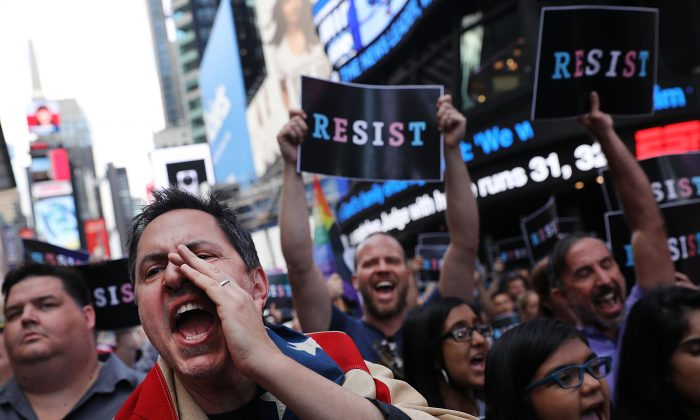 Dozens of anti-Trump protesters gather in Times Square, New York, on July 26, 2017. Commentators have said that the tactics used by the Anti-Trump Resistance have started to embody the very things they are protesting about. (Spencer Platt/Getty Images)