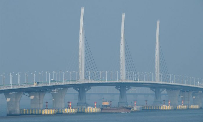 Buses drive on a section of the Hong Kong-Macau-Zhuhai Bridge on Oct. 24, 2018. (Anthony Wallace/AFP/Getty Images)