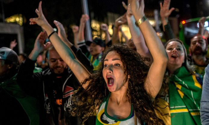 Supporters of Jair Bolsonaro celebrate victory in the presidential elections in Sao Paulo on Oct. 28, 2018. (Victor Moriyama/Getty Images)