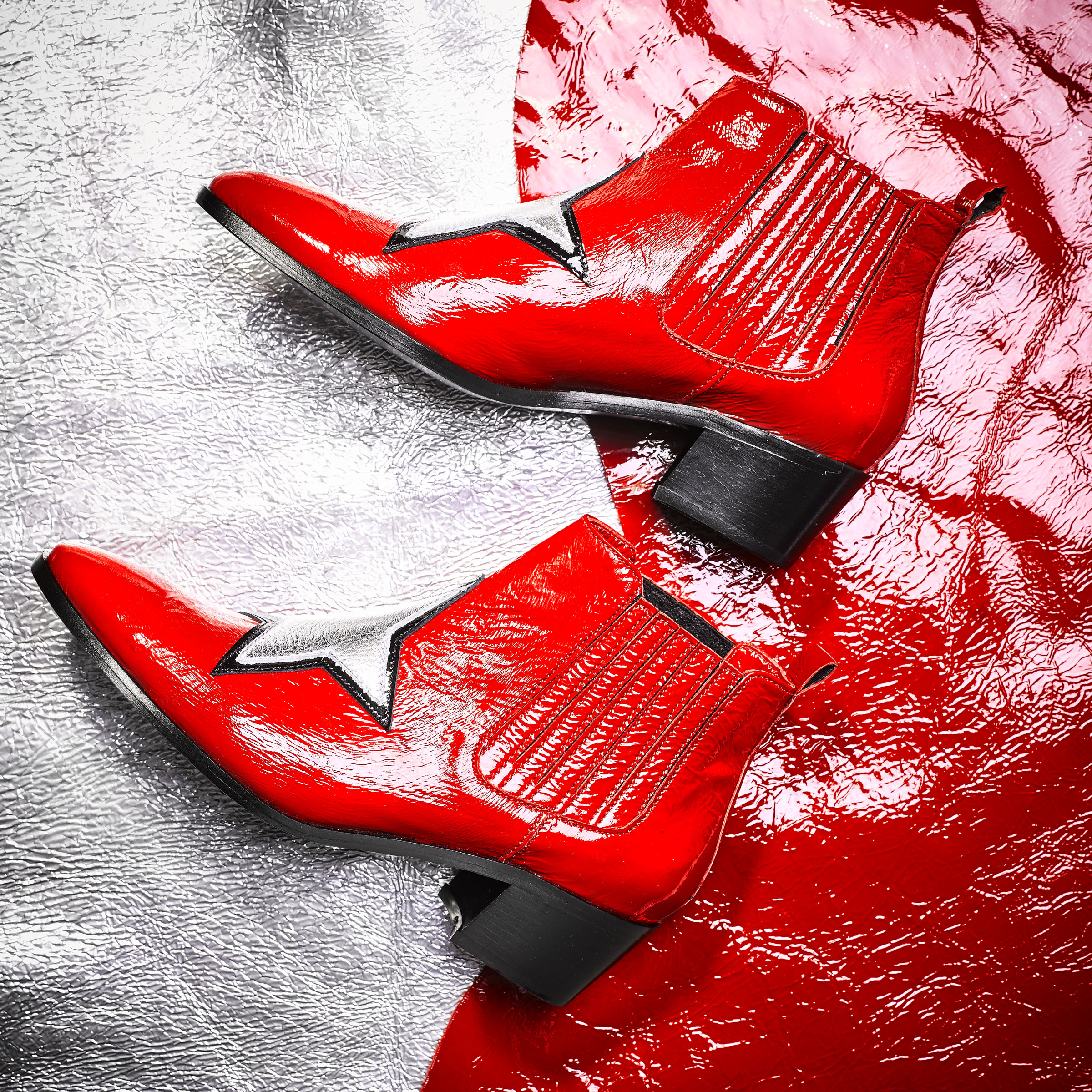 Red boots with silver stars by Modern Vice