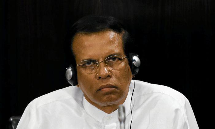 Sri Lanka's President Maithripala Sirisena listens to a speech during a Parliament session marking the  70th anniversary of Sri Lanka's Government, in Colombo, Sri Lanka Oct. 3, 2017. (Dinuka Liyanawatte/Reuters)