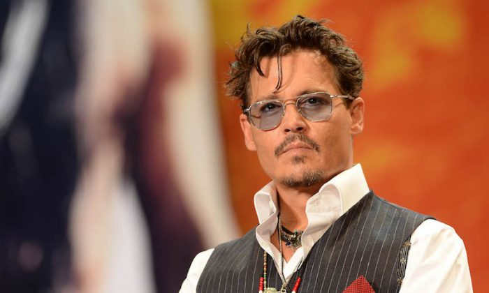 Johnny Depp on July 17, 2013 in Tokyo, Japan. Johnny Depp has been dropped from the 'Pirates Of the Caribbean' film franchise. (Atsushi Tomura/Getty Images)