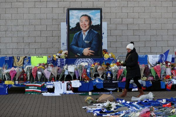 A woman places flowers outside Leicester City's King Power stadium