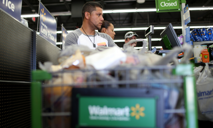 Saul Trana stands in the check-out line as he shops at a Walmart store on February 19, 2015 in Miami, Florida.  (Joe Raedle/Getty Images)