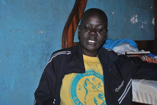 Caroline Achieng', a breast cancer patient living in Kariobangi slums in Nairobi.