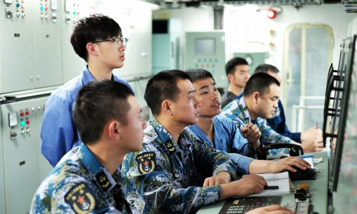 People's Liberation Army sailors working on board China's first domestically manufactured aircraft carrier, during its first sea trial at sea on May 18, 2018. (AFP/Getty Images)