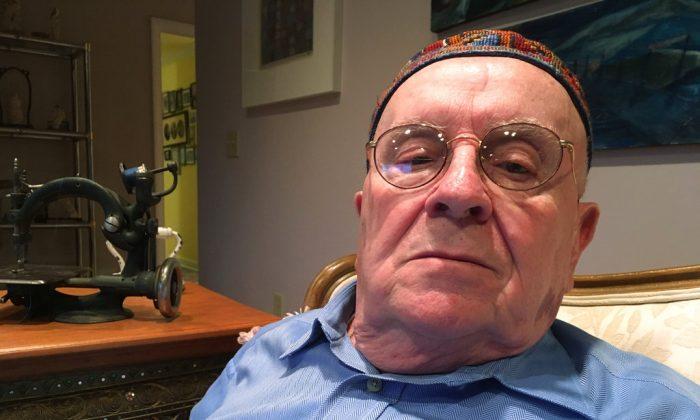 Holocaust survivor Judah Samet, 80, sits in his living room in Pittsburgh on Oct. 29, 2018. (AP Photo/Allen G. Breed)