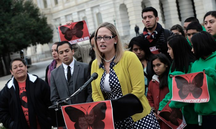 Rep. Kyrsten Sinema (D-AZ) speaks at a press conference held by the Dream Action Coalition on immigration reform in Washington, on Dec. 4, 2013. (Win McNamee/Getty Images)