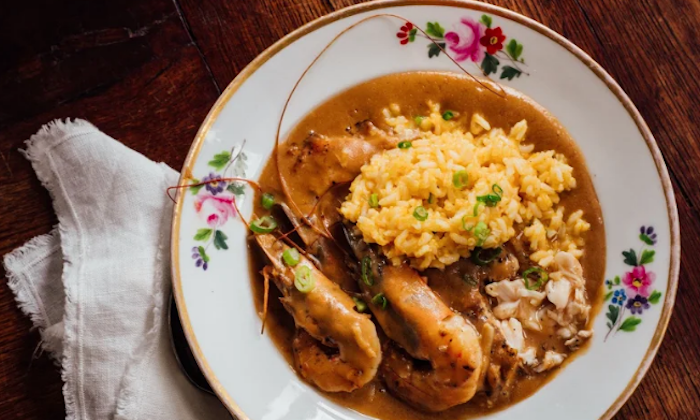 Toups' grandmother's gulf seafood couvillion is thickened with roux and a whole fish. (Denny Culbert)