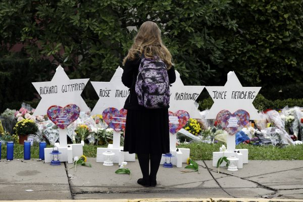 a person stands in front of a memorial