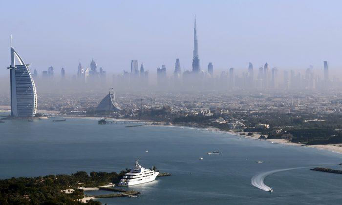 Burj Khalifa, the world's tallest tower, and luxury Burj al-Arab Hotel (L) are seen in a general view of Dubai, UAE, on Dec. 9, 2015. (Reuters/Karim Sahib/Pool/File Photo)