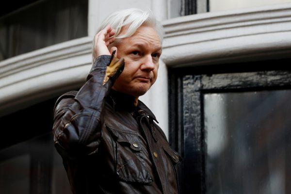 WikiLeaks founder Julian Assange is seen on the balcony of the Ecuadorian Embassy in London