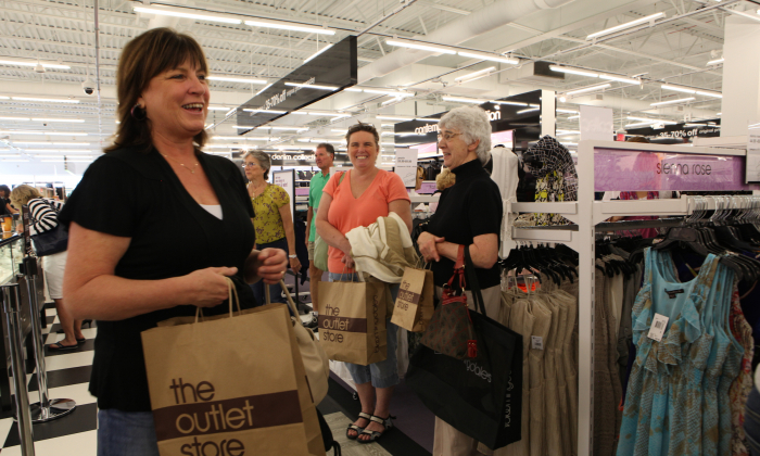Customers attend Bloomingdale's, The Outlet Store Opening, on June 14, 2012 in Merrimack, New Hampshire. (Gail Oskin/Getty Images for Bloomingdale's)