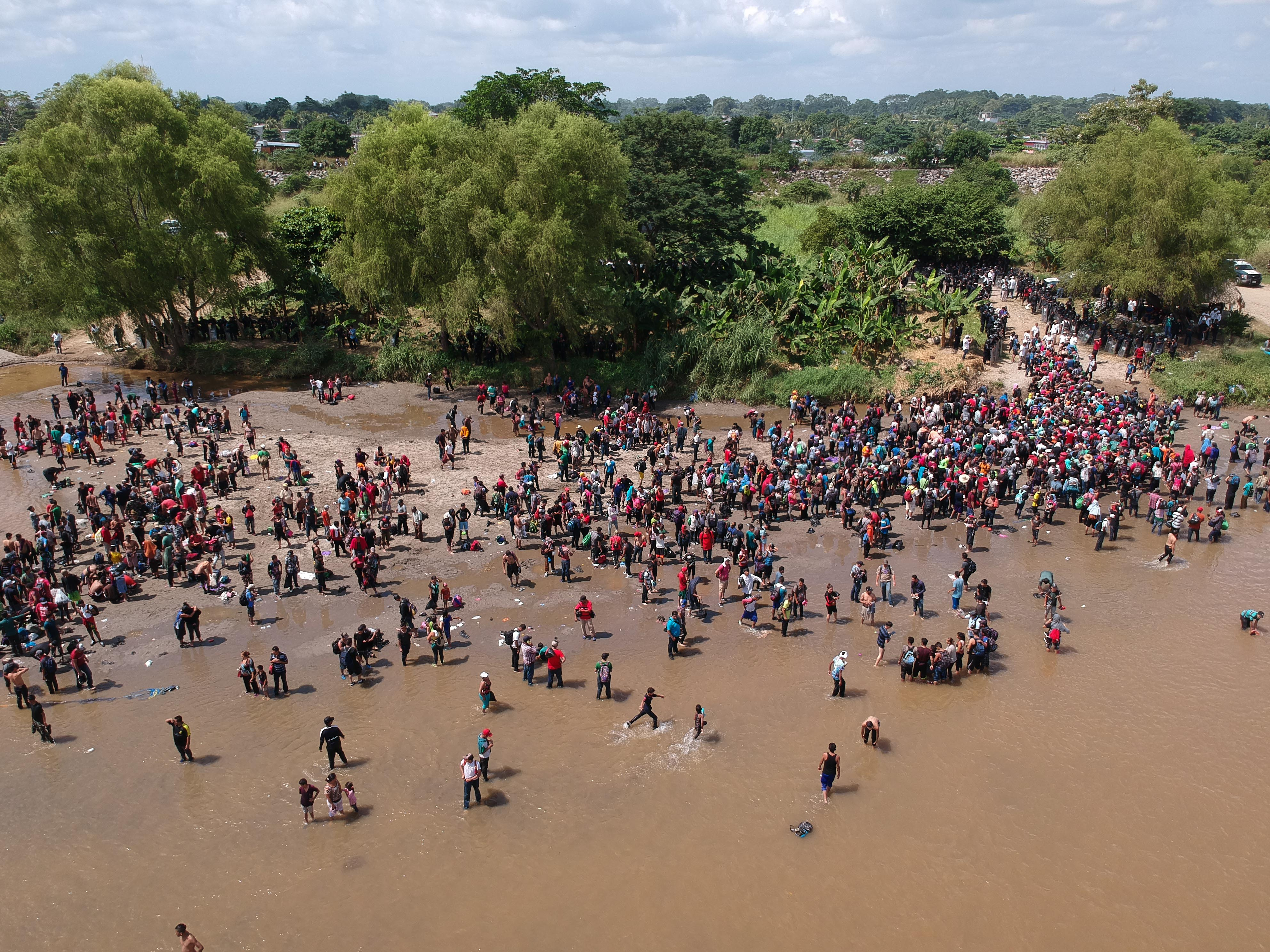 Migrants reaching Mexico after crossing the Suchiate River from Tecun Uman in Guatemala to Ciudad Hidalgo in Mexico