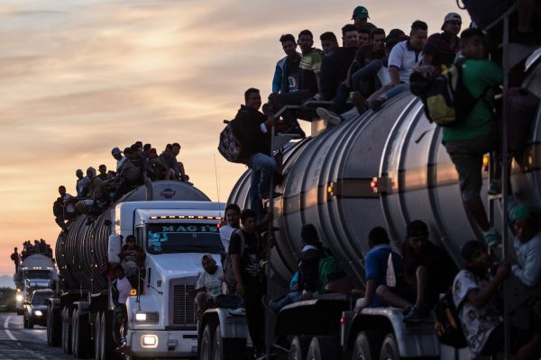 A truck carrying mostly Honduran migrants taking part in a caravan heading to the US drives from Santiago Niltepec to Juchitan, near the town of La Blanca in Oaxaca State, Mexico