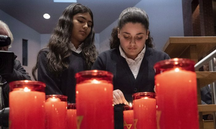 Candles are lit, one for each of the 11 victims, during a Montreal Jewish Community Memorial Vigil for the victims of the Pittsburgh synagogue attack in Montreal on Oct. 29, 2018. (The Canadian Press/Paul Chiasson)