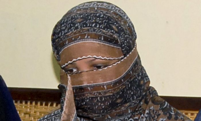Asia Bibi, a Pakistani Christian woman, listens to officials at a prison in Sheikhupura near Lahore, Pakistan, on Oct. 31, 2018. (AP)