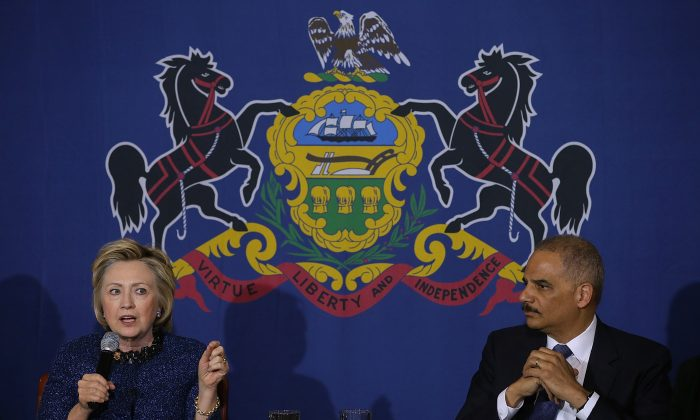 Then-Democratic presidential candidate and former Secretary of State Hillary Clinton and former Attorney General Eric Holder participate in a panel discussion in Philadelphia, on April 20, 2016. (Justin Sullivan/Getty Images)