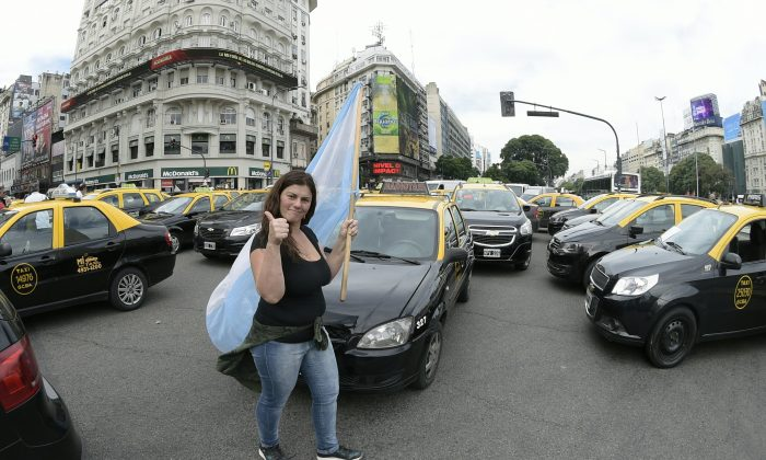 Taxi drivers block streets during a protest against Uber in Buenos Aires, Argentina, on Apr. 20, 2016. On top of protests, taxi cartels have resorted to vandalism to protect their market.  (JUAN MABROMATA/AFP/Getty Images)