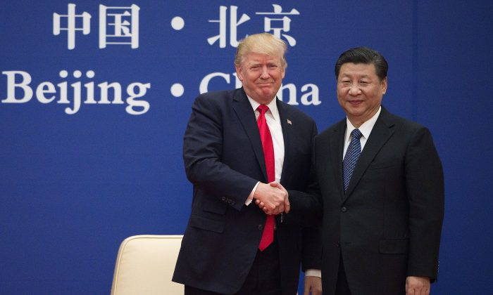 U.S. President Donald Trump and Chinese leader Xi Jinping shake hands at the Great Hall of the People in Beijing on Nov. 9, 2017. (Nicolas Asfouri/AFP/Getty Images)