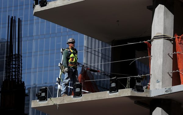A construction worker on a floor of a building under construction in San Francisco