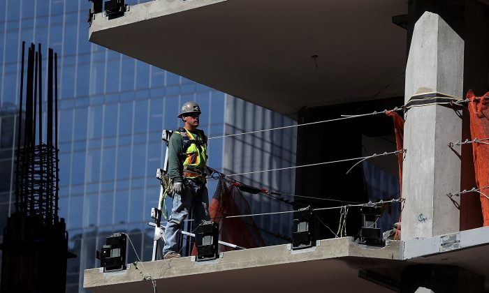 A construction worker on a floor of a building under construction in San Francisco on Oct. 5, 2018. (Justin Sullivan/Getty Images)