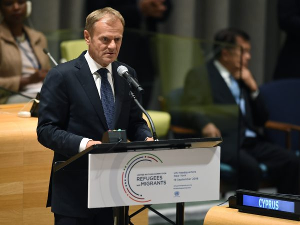 European Council President Donald Tusk speaks at a podium