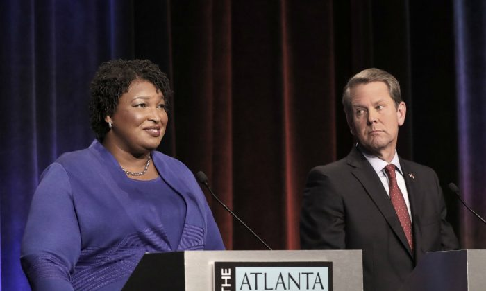 Georgia gubernatorial candidates (L-R) Democrat Stacey Abrams and Republican Brian Kemp debate in an event that also included Libertarian Ted Metz at Georgia Public Broadcasting in Midtown Oct. 23, 2018 in Atlanta, Georgia. (John Bazemore-Pool/Getty Images)