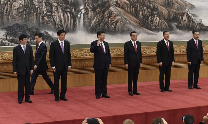 Chinese President Xi Jinping (Center) and other new members of the Communist Party of China's Politburo Standing Committee (L-R) Wang Huning, Han Zheng, Li Zhanshu, Li Keqiang, Wang Yang, Zhao Leji meet press in Beijing's Great Hall of the People on October 25, 2017. (WANG ZHAO/AFP/Getty Images)