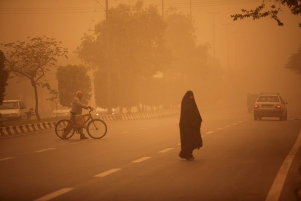 Iranians cross a street in Khuzestan