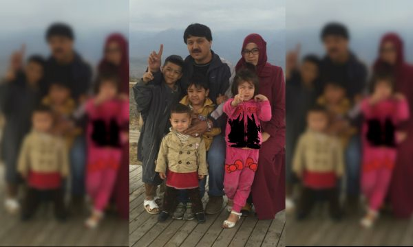 Abdukadir with his wife and four children
