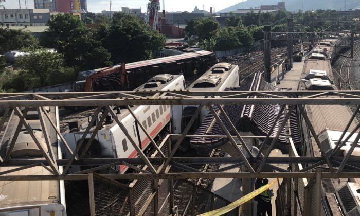 An overturned train is seen in Yilan, Taiwan Oct. 22, 2018. (Reuters/Yimou Lee)