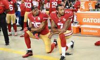 First NFL Cheerleader Kneels During National Anthem