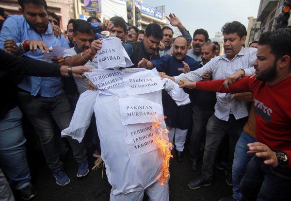 Demonstrators burn depicting terrorism