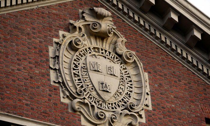 A seal hangs over a building at Harvard University in Cambridge, Massachusetts, on Nov. 16, 2012. (Jessica Rinaldi//File Photo/Reuter)
