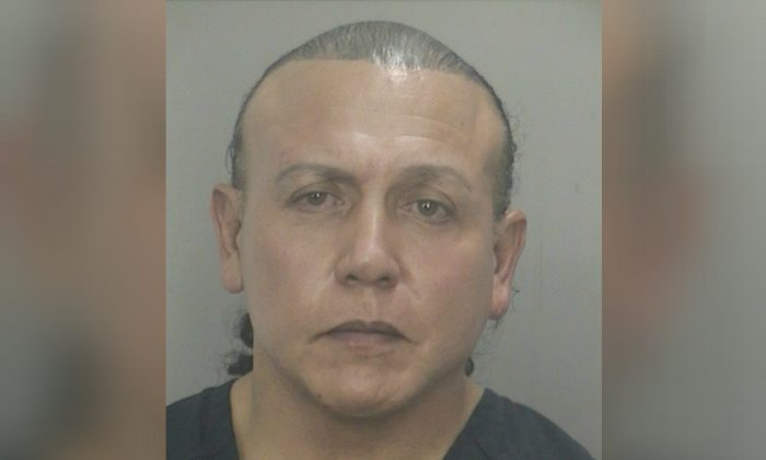 Cesar Altieri Sayoc is pictured in Ft. Lauderdale, Florida, in this Nov. 28, 2013 handout booking photo. (Broward County Sheriff's Office/Handout via Reuters/File Photo)