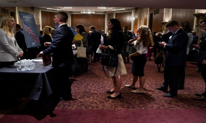 People wait in line at a stand during the Executive Branch Job Fair hosted by the Conservative Partnership Institute at the Dirksen Senate Office Building in Washington, on June 15, 2018. (Toya Sarno Jordan/Reuters)